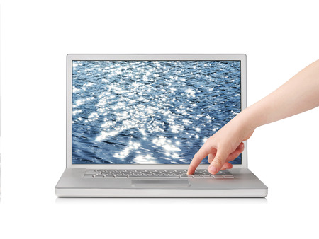 screensaver: Finger pressing button on notebook with sea screensaver, isolated on white Stock Photo