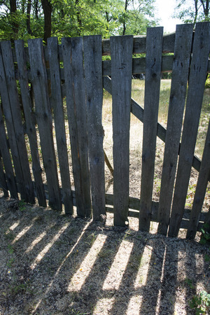 wicked: Closed wicked gates in wooden fence, rural motif