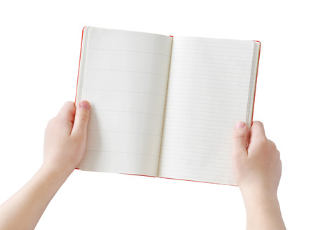 spotless: Two hands holding opened empty paper notebook, isolated, clipping path Stock Photo