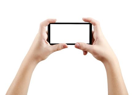 cogidos de la mano: Dos manos sosteniendo teléfono inteligente de pantalla grande, camino de recortes