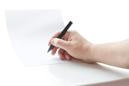 Human hand signing blank white sheet of paper using pen Stock Photo
