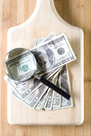 Well used chopping board and dollar  Stock Photo
