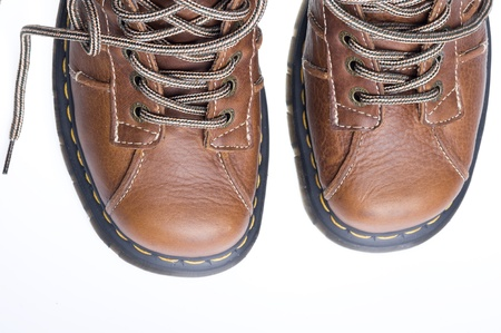 drown: Brown leather boot over white background