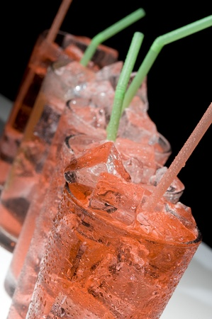 Red cocktail and ice. Cold de a alcoholic drink