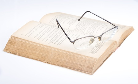Eyeglasses on a book. Has put on the book glasses