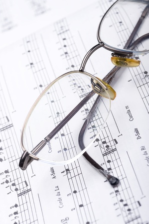 Background of music. Note pad and glasses  Stock Photo
