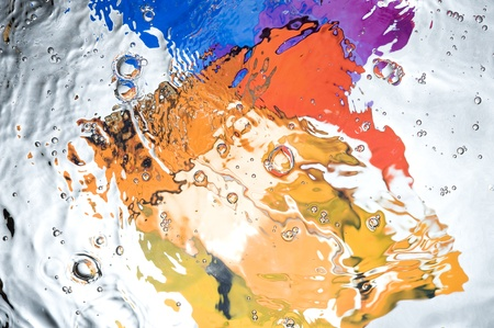 Background with colourful splashing  water. Creative abstract