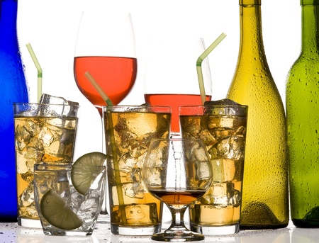 Glass with alcohol and ice on white background