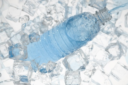Mineral water with ice. Blue background with plastic bottle Stock fotó - 10935348