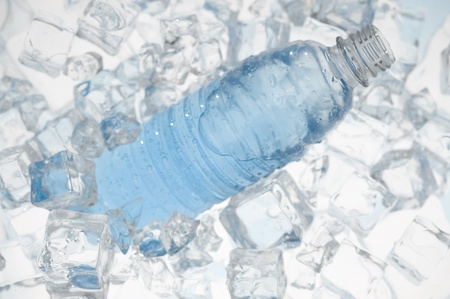 Mineral water with ice. Blue background with plastic bottle Stock fotó - 10935343