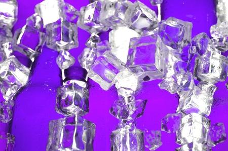 Brown beer bottles and clear ice . Cider bottle
