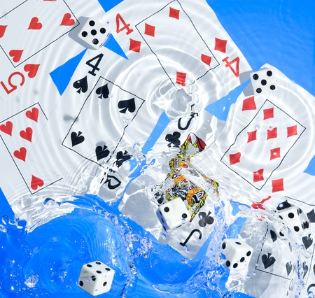 Several dice combination and playing cards on water