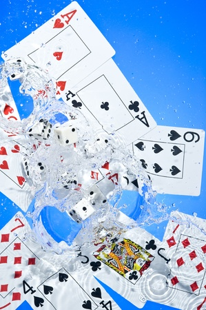Several dice combination and playing cards on water  photo