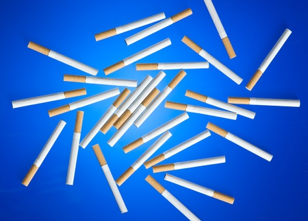 helthcare: Cigarette on blue background. Cood for anti smoking issues