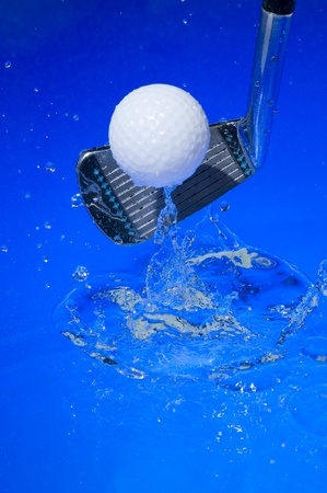 Golf club in blue water. Club with ball   Stock Photo