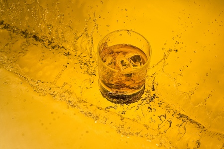 Class of  whisky on creative brown background with water Stock Photo - 11030557