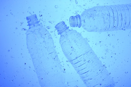 Background with Plastic bottle in blue water  photo