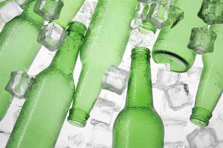 Green beer bottles and clear ice   photo