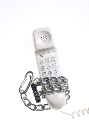 Telephone and chain isolated on white  Stock Photo