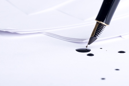 Pen on the white paper