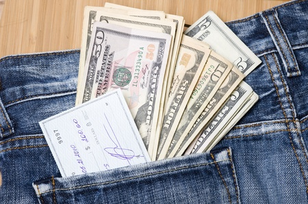 Jeans pocket with dollars. Finance abstract