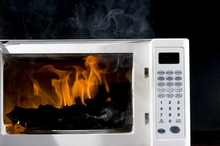Microwave is broken filled hot flame  Stock Photo