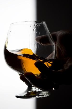 Cognac on the glass . Brown scotch