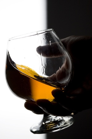 Cognac on the glass . Brown scotch  photo