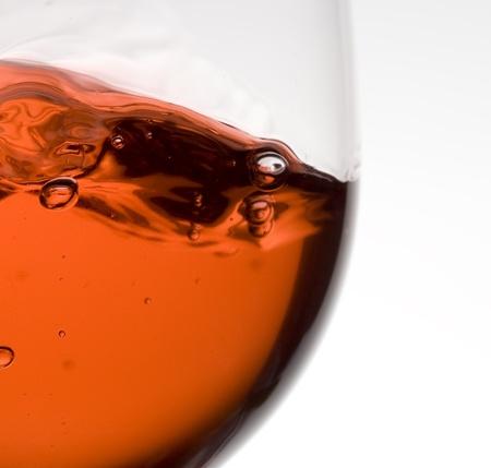 Splashing red wine.Pouring wine