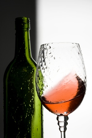 Splashing red wine and bottle  photo