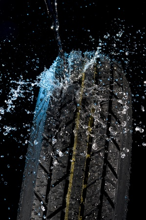 Tire with water drops on it black background  Stok Fotoğraf