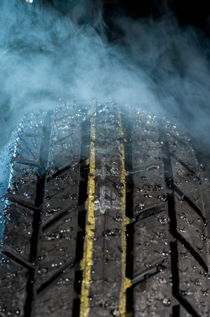Tire with water drops on it smoke background