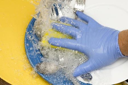 Washing kitchen ware on the silk  photo