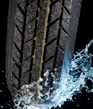 Tire with water drops on it black background  Stock Photo