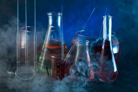 Chemistry flask on the dark background Archivio Fotografico