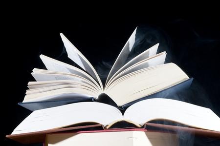 Books isolated on the black background  Sajtókép