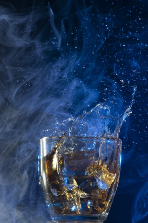 Pouring Whisky . Brandy with ice
