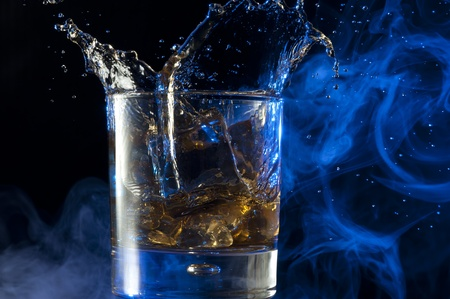 Pouring Whisky . Brandy with ice photo
