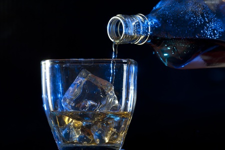 whisky bottle: Pouring Whisky . Brandy with ice