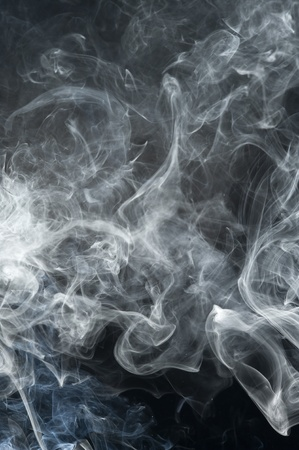 Black background with gray smoke