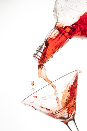 Splashing red drink isolated on the white Stock Photo