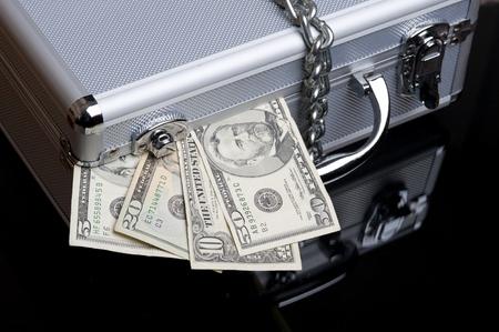 Dollars on the aluminum case