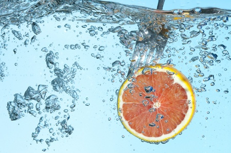 Fresh orange on the water Stock Photo