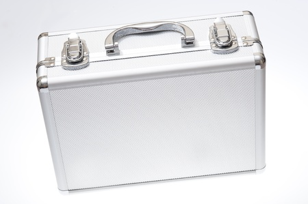 Metal suitcase isolated on the white background