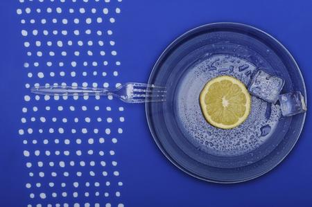 Fresh lemon on the blue plate. Vegetarian food