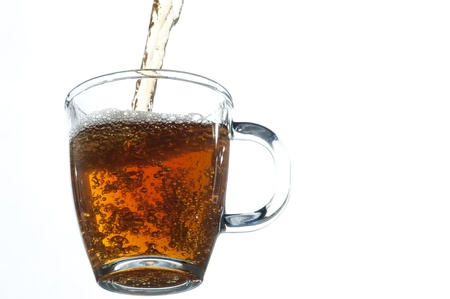 Fresh tea pouring on the glass , white background Imagens