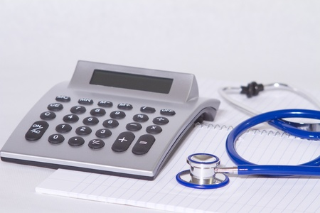 Stethoscope and calculator on the white background Reklamní fotografie