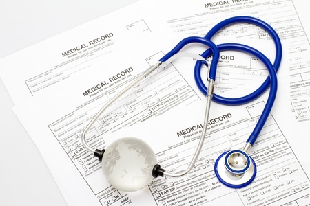 A prescription form and stethoscope on a doctors desk Stock Photo