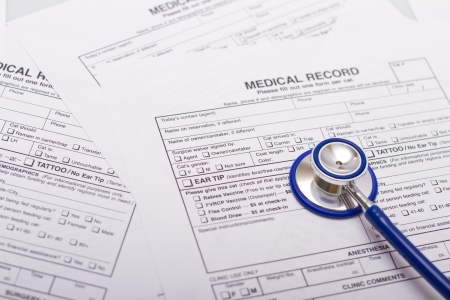 medical records: A prescription form and stethoscope on a doctors desk Stock Photo