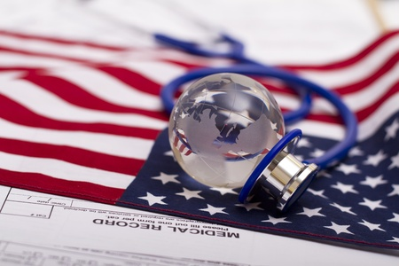 Stethoscope and globe on a USA flag Stock Photo